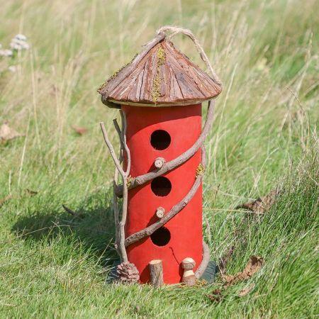 Tall Round Red Birds Nest